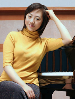 zhu yellow shirt seated sized km